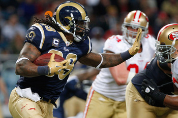 ST. LOUIS, MO - JANUARY 1:  Running back Steven Jackson #39 of the St. Louis Rams runs the ball against the San Francisco 49ers in the first half of the game on January 1, 2012 at the Edward Jones Dome in St. Louis, Missouri. The 49ers defeated the Rams 3