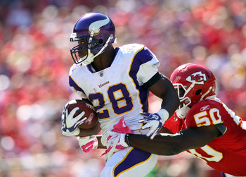 KANSAS CITY, MO - OCTOBER 02:  Adrian Peterson #28 of the Minnesota Vikings carries the ball as linebacer Justin Houston #50 of the Kansas City Chiefs defends during the game on October 2, 2011 at Arrowhead Stadium in Kansas City, Missouri.  (Photo by Jam
