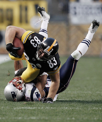 PITTSBURGH, PA - OCTOBER 30:  Heath Miller #83 of the Pittsburgh Steelers dives over an attempted tackle by Patrick Chung #25 of the New England Patriots during the game on October 30, 2011 at Heinz Field in Pittsburgh, Pennsylvania.  (Photo by Jared Wick