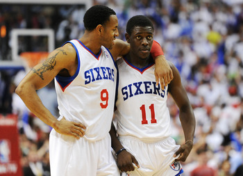 PHILADELPHIA, PA - MAY 18: Andre Iguodala #9 and Jrue Holiday #11 of the Philadelphia 76ers talk at the end of the game against the Boston Celtics in Game Four of the Eastern Conference Semifinals in the 2012 NBA Playoffs at the Wells Fargo Center on May