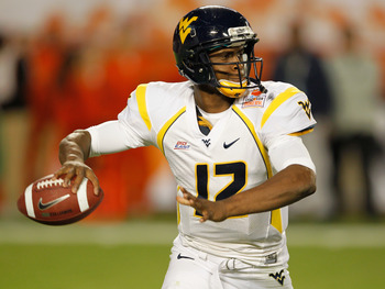 MIAMI GARDENS, FL - JANUARY 04:  Geno Smith #12 of the West Virginia Mountaineers throws a pass against the Clemson Tigers during the Discover Orange Bowl at Sun Life Stadium on January 4, 2012 in Miami Gardens, Florida.  (Photo by Streeter Lecka/Getty Im