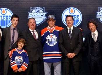 PITTSBURGH, PA - JUNE 22:  Nail Yakupov (C), first overall pick by the Edmonton Oilers, poses onstage with Oilers team representatives during Round One of the 2012 NHL Entry Draft at Consol Energy Center on June 22, 2012 in Pittsburgh, Pennsylvania.  (Pho