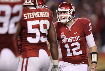 TEMPE, AZ - DECEMBER 30:  Quarterback Landry Jones #12 of the Oklahoma Sooners during the Insight Bowl against the Iowa Hawkeyes at Sun Devil Stadium on December 30, 2011 in Tempe, Arizona.  (Photo by Christian Petersen/Getty Images)