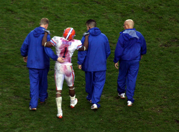 Percy Harvin is helped off the field after spraining his ankle in the second quarter.
