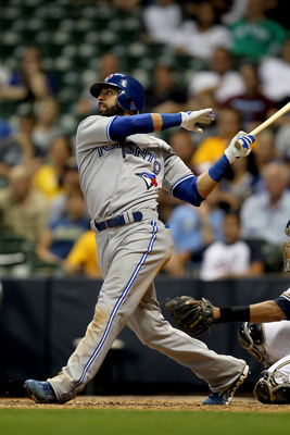 MILWAUKEE, WI - JUNE 19: Jose Bautista #19 of the Toronto Blue Jays sends this pitch over the wall for a solo home run in the top of the 9th inning against the Milwaukee Brewers during the Interleague game at Miller Park on June 19, 2012 in Milwaukee, Wis