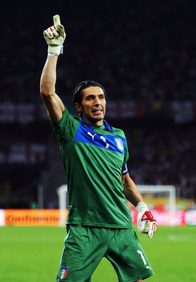 Buffon stands in celebration after defeating England 4-2 on penalties.