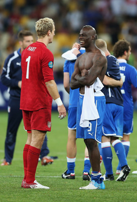 Balotelli speaks with Manchester City teammate and England keeper Joe Hart after the victory.