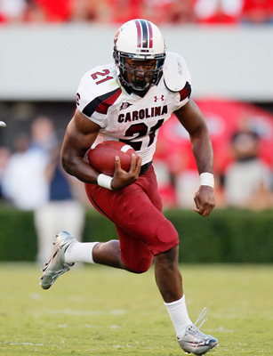 ATHENS, GA - SEPTEMBER 10:  Marcus Lattimore #21 of the South Carolina Gamecocks rushes upfield against the Georgia Bulldogs at Sanford Stadium on September 10, 2011 in Athens, Georgia.  (Photo by Kevin C. Cox/Getty Images)