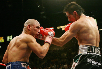 Miguel Cotto (left) suffered his first defeat to Antonio Margarito in 2008.