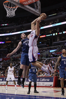 Blake Griffin goes up for a monster-dunk against power forward rival, Kevin Love.