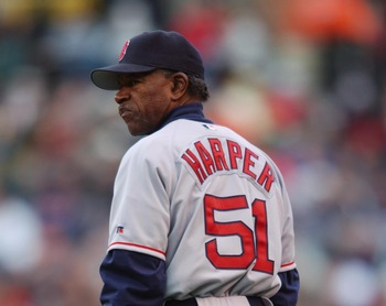 BALTIMORE - APRIL 6:  First base coach Tommy Harper  #51 of the Boston Red Sox stands on the field during the MLB game against the Baltimore Orioles at Camden Yards in Baltimore, Maryland on April 6, 2002. The Red Sox won 4-2. (Photo by Doug Pensinger/Get