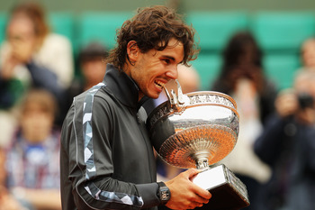 Rafa chewing on the Coupe des Mousquetaires