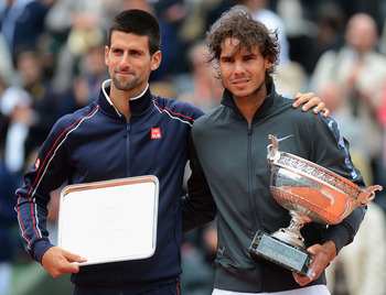 Novak Djokovic embraces Rafa after the 2012 French Open