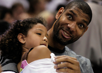 SAN ANTONIO, TX - JUNE 04:  Tim Duncan #21 of the San Antonio Spurs sits with his daughter prior to in Game Five of the Western Conference Finals of the 2012 NBA Playoffs at AT&T Center on June 4, 2012 in San Antonio, Texas. NOTE TO USER: User expressly a
