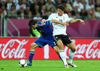 GDANSK, POLAND - JUNE 22:  Mario Gomez of Germany competes with Sokratis Papastathopoulos of Greece during the UEFA EURO 2012 quarter final match between Germany and Greece at The Municipal Stadium on June 22, 2012 in Gdansk, Poland.  (Photo by Joern Poll
