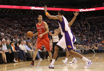 PHOENIX, AZ - FEBRUARY 09:  Kevin Martin #12 of the Houston Rockets looks to pass against the Phoenix Suns during the NBA game at US Airways Center on February 9, 2012 in Phoenix, Arizona. The Rockets defeated the Suns 96-89. NOTE TO USER: User expressly