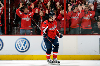 WASHINGTON, DC - MARCH 31:  Alexander Semin #28 of the Washington Capitals celebrates after scoring the game winning goal in the shootout against the Montreal Canadiens at the Verizon Center on March 31, 2012 in Washington, DC. The Capitals won the game 3