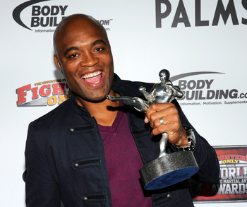LAS VEGAS, NV - NOVEMBER 30:  Mixed martial artist Anderson Silva holds the Knockout of the Year award for his victory over Vitor Belfort at UFC 126 at the Fighters Only World Mixed Martial Arts Awards 2011 at The Pearl concert theater at the Palms Casino
