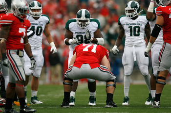 COLUMBUS, OH - OCTOBER 1:  Anthony Rashad White #98 of the Michigan State Spartans taunts Corey Linsley #71 of the Ohio State Buckeyes after he was called for a false start on October 1, 2011 at Ohio Stadium in Columbus, Ohio. (Photo by Kirk Irwin/Getty I