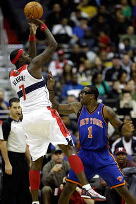 WASHINGTON, DC - JANUARY 06: Andray Blatche #7 of the Washington Wizards shoots over the defense of Amare Stoudemire #1 of the New York Knicks durng the first half at Verizon Center on January 6, 2012 in Washington, DC.  NOTE TO USER: User expressly ackno