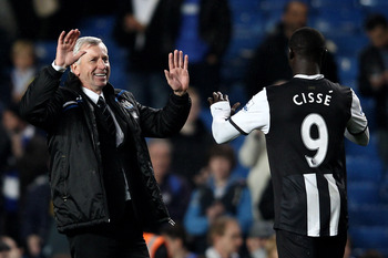 LONDON, ENGLAND - MAY 02:  Alan Pardew the Newcastle manager celebrates with two goal hero Papiss Cisse of Newcastle after the final whistle during the Barclays Premier League match between Chelsea and Newcastle United at Stamford Bridge on May 2, 2012 in