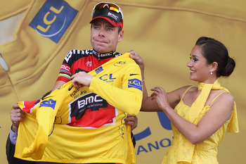 GRENOBLE, FRANCE - JULY 23:  Cadel Evans of Australia and BMC Racing Team  becomes the race leaders yellow jersey after the Individual Time Trial Stage 20 of the 2011 Tour de France on July 23, 2011 in Grenoble, France.  (Photo by Michael Steele/Getty Ima