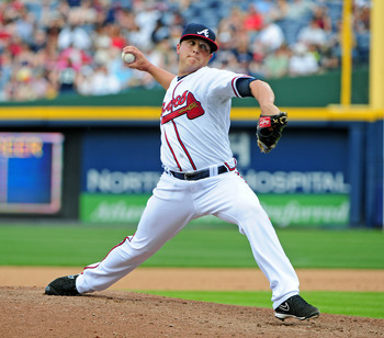 ATLANTA - APRIL 15: Kris Medlen of the Atlanta Braves pitches against the Milwaukee Brewers at Turner Field on April 15, 2012 in Atlanta, Georgia. All uniformed team members are wearing jersey number 42 in honor of Jackie Robinson Day. (Photo by Scott Cun