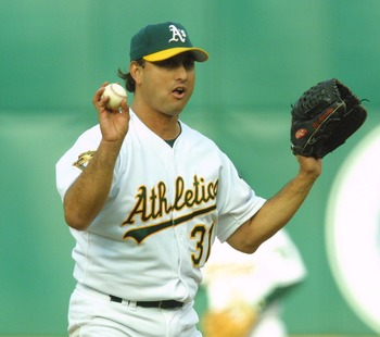 15 Apr 2001: Gil Heredia #31  of the Oakland A's  motions he has had enough against the the Texas Rangers at the Network Associates Coliseum in Oakland, California. DIGITAL IMAGE Mandatory Credit: Tom Hauck/ALLSPORT