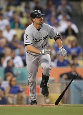 LOS ANGELES, CA - JUNE 15:  Paul Konerko #14 of the Chicago White Sox runs to first base during the MLB game against the Los Angeles Dodgers at Dodger Stadium on June 15, 2012 in Los Angeles, California. The Dodgers defeated the White Sox 7-6.  (Photo by
