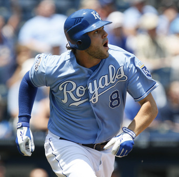 KANSAS CITY, MO - JUNE 27:  Mike Moustakas #8 of the Kansas City Royals runs to first after hitting a home run against the Tampa Bay Rays in the first inning at Kauffman Stadium on June 27, 2012 in Kansas City, Missouri. (Photo by Ed Zurga/Getty Images)