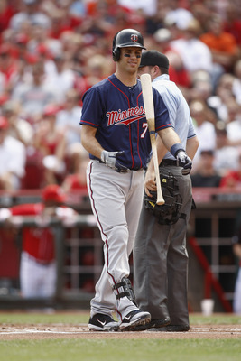 CINCINNATI, OH - JUNE 23:  Joe Mauer #7 of the Minnesota Twins flips his bat after striking out during the interleague game against the Cincinnati Reds at Great American Ball Park on June 23, 2012 in Cincinnati, Ohio.  (Photo by John Grieshop/Getty Images