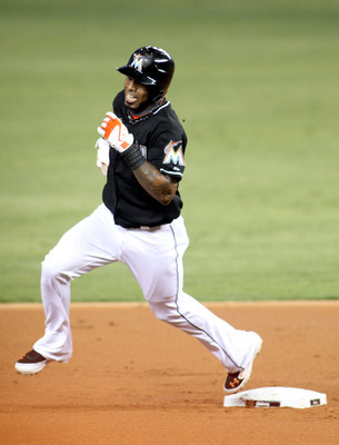 MIAMI, FL - MAY 11: Jose Reyes #7 of the Florida Marlins rounds second base on his way to a triple against the New York Mets at Marlins Park on May 11, 2012 in Miami, Florida. The Marlins defeated the Mets 6-5. (Photo by Marc Serota/Getty Images)