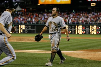PHILADELPHIA, PA - JUNE 26: Michael McKenry #55 of the Pittsburgh Pirates walks back to the dugout after being tagged out at home in the seventh inning of the game against the Philadelphia Phillies at Citizens Bank Park on June 26, 2012 in Philadelphia, P