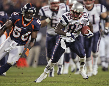 New England Patriots wide receiver Deion Branch (83) tries to outrun Denver Broncos linebacker Al Wilson (56) Saturday, January 14, 2006 at Invesco Field at Mile High in Denver, CO. The Denver Broncos defeated the New England Patriots 27-13 to win the AFC