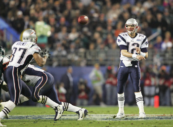 JACKSONVILLE, FL - FEBRUARY 6:  Quarterback Tom Brady #12 of the New England Patriots throws a pass to wide receiver David Givens #87 against the Philadelphia Eagles in Super Bowl XXXIX at Alltel Stadium on February 6, 2005 in Jacksonville, Florida. The P