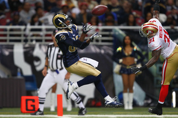 ST. LOUIS, MO - JANUARY 1: Brandon Lloyd #83 of the St. Louis Rams catches a touchdown pass against Donte Whitner #31 of the San Francisco 49ers at the Edward Jones Dome on January 1, 2012 in St. Louis, Missouri.  The 49ers beat the Rams 34-27.  (Photo by