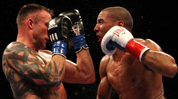 Mikkel Kessler braces for an Andre Ward punch