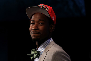NEWARK, NJ - JUNE 28:  Terrence Ross (R) of the Washington Huskies walks off stage after he was selected number eight overall by the Toronto Raptors during the first round of the 2012 NBA Draft at Prudential Center on June 28, 2012 in Newark, New Jersey.