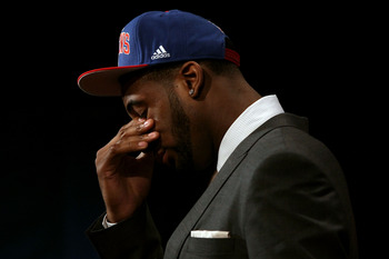 NEWARK, NJ - JUNE 28:  Andre Drummond (R) of the Connecticut Huskies walks off stage after he was selected number nine overall by the Detroit Pistons during the first round of the 2012 NBA Draft at Prudential Center on June 28, 2012 in Newark, New Jersey.