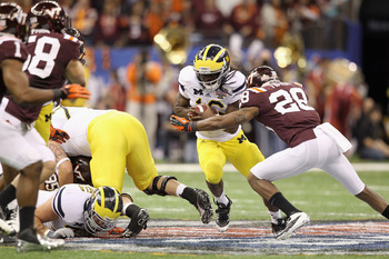 NEW ORLEANS, LA - JANUARY 03:  Denard Robinson #16 of the Michigan Wolverines runs the ball against Alonzo Tweedy #28 of the Virginia Tech Hokies during the Allstate Sugar Bowl at Mercedes-Benz Superdome on January 3, 2012 in New Orleans, Louisiana.  (Pho