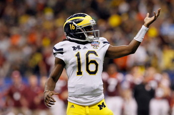 NEW ORLEANS, LA - JANUARY 03:  Denard Robinson #16 of the Michigan Wolverines celebrates after he threw an 18-yard touchdown pass to Junior Hemingway #21 in the third quarter against the Virginia Tech Hokies during the Allstate Sugar Bowl at Mercedes-Benz