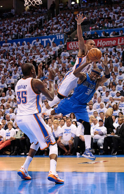 OKLAHOMA CITY, OK - APRIL 30:  Russell Westbrook #0 of the Oklahoma City Thunder fouls Jason Terry #31 of the Dallas Mavericks of the Dallas Mavericks in Game Two of the Western Conference Quarterfinals in the 2012 NBA Playoffs on April 30, 2012 at the Ch
