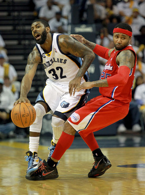 MEMPHIS, TN - APRIL 29:  O.J. Mayo #32 of the Memphis Grizzlies and Mo Williams #25 of the Los Angeles Clippers collide in Game One of the Western Conference Quarterfinals in the 2012 NBA Playoffs at FedExForum on April 29, 2012 in Memphis, Tennessee.  NO