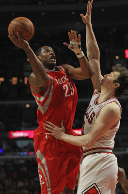 CHICAGO, IL - APRIL 02:  Marcus Camby #29 of the Houston Rockets shoots against Omer Asik #3 of the Chicago Bulls at the United Center on April 2, 2012 in Chicago, Illinois. The Rockets defeated the Bulls 99-93. NOTE TO USER: User expressly acknowledges a