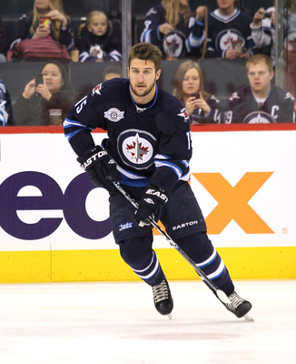 Tanner Glass with Winnipeg in 2011-12.