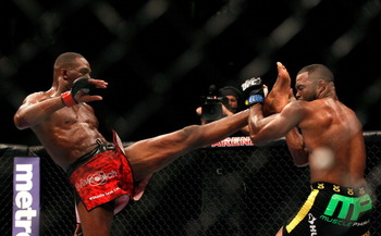 Jon Jones (left) working the front kick.