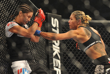 Gina Carano (left) gets attacked by Cristiane Santos (right).