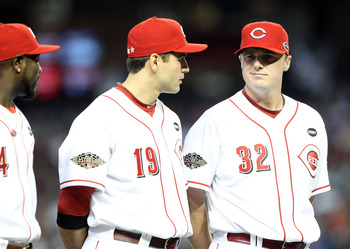 PHOENIX, AZ - JULY 12:  National League All-Star Joey Votto #19 of the Cincinnati Reds talks with National League All-Star Jay Bruce #32 of the Cincinnati Reds before the start of the 82nd MLB All-Star Game at Chase Field on July 12, 2011 in Phoenix, Ariz