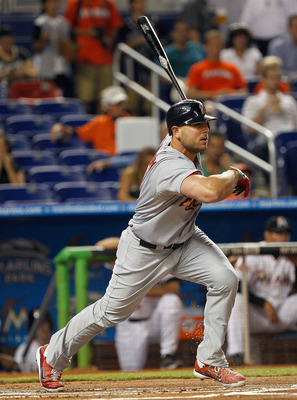 MIAMI, FL - JUNE 26:  Matt Holliday #7 of the St. Louis Cardinals hits during a game against the Miami Marlins at Marlins Park on June 26, 2012 in Miami, Florida.  (Photo by Mike Ehrmann/Getty Images)