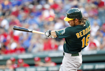ARLINGTON, TX - JUNE 28: Josh Reddick #16 of the Oakland Athletics hits a home run in the first inning against the Texas Rangers at Rangers Ballpark in Arlington on June 28, 2012 in Arlington, Texas. (Photo by Rick Yeatts/Getty Images)